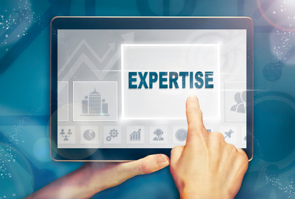 A hand selecting a Expertise business concept on a clear screen with a colorful blurred background.