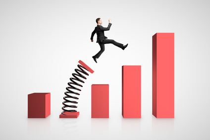 Businessman launching on spring chart. Financial growth and success concept.